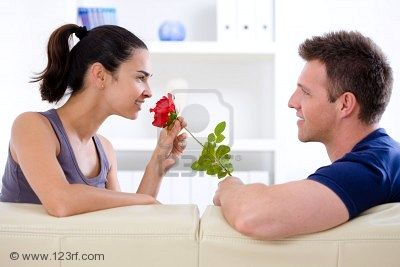 3861547-romantic-man-giving-red-rose-to-woman--valentine-s-day